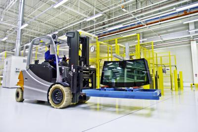 Forklift loader in large modern warehouse