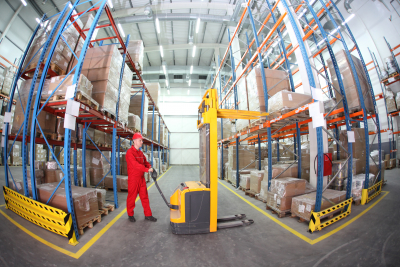 A man in red uniform at work in warehouse